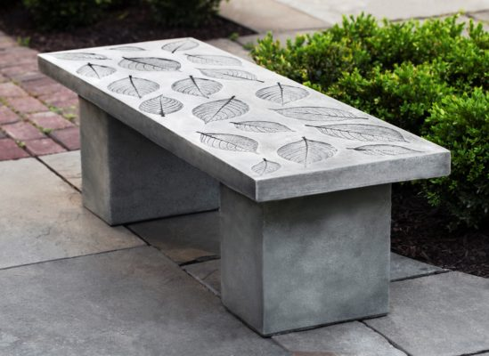 stone garden bench featuring leaf imprint pattern