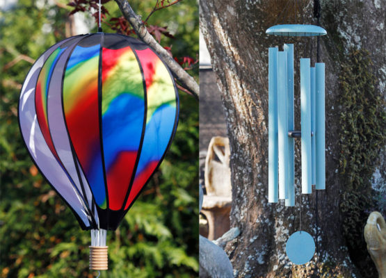 colorful wind balloon and wind chimes in tree at stone garden