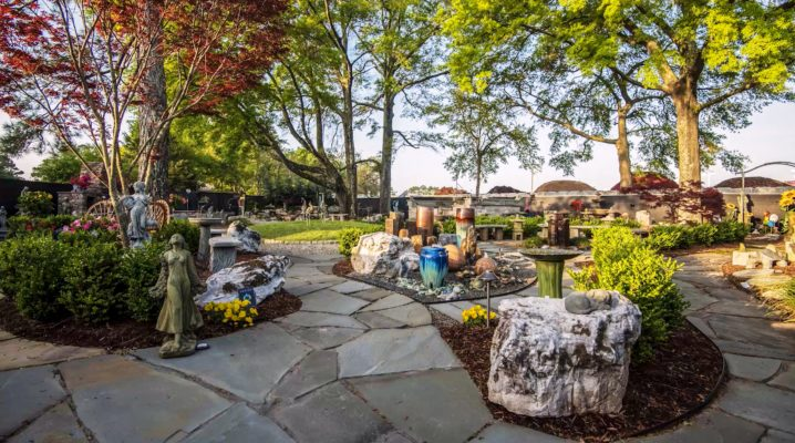 stone garden inspiration garden pathway with art, fountains, boulders, grill surround, and trees