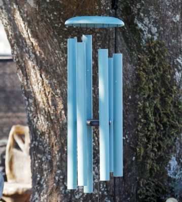 metal wind chimes at stone garden