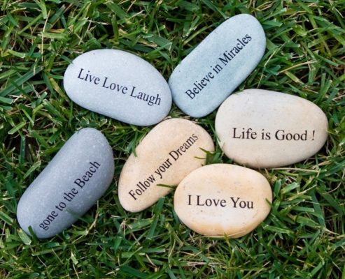 word engraving on stone rock gift collection in the garden