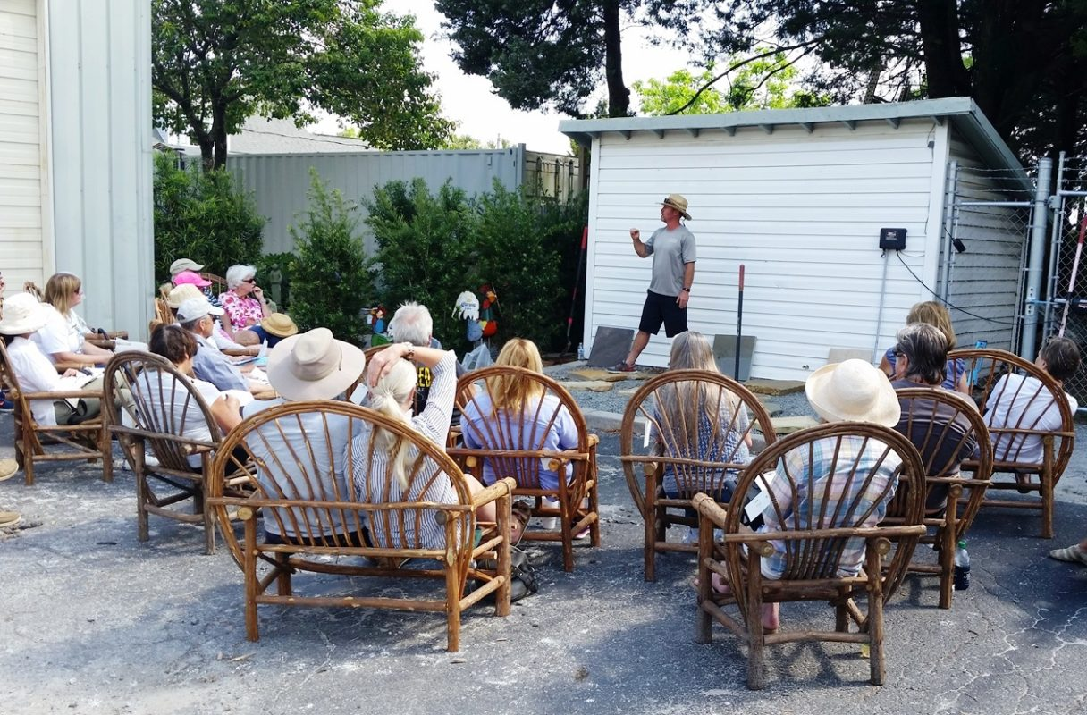 stone garden employee holding pathway and patio DIY class for homeowners in the summer time