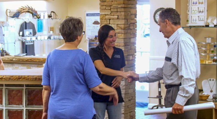 stone garden employee Emily shaking hands with a customer in the office shop