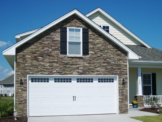 cultured stone veneer facade on exterior wall of a home