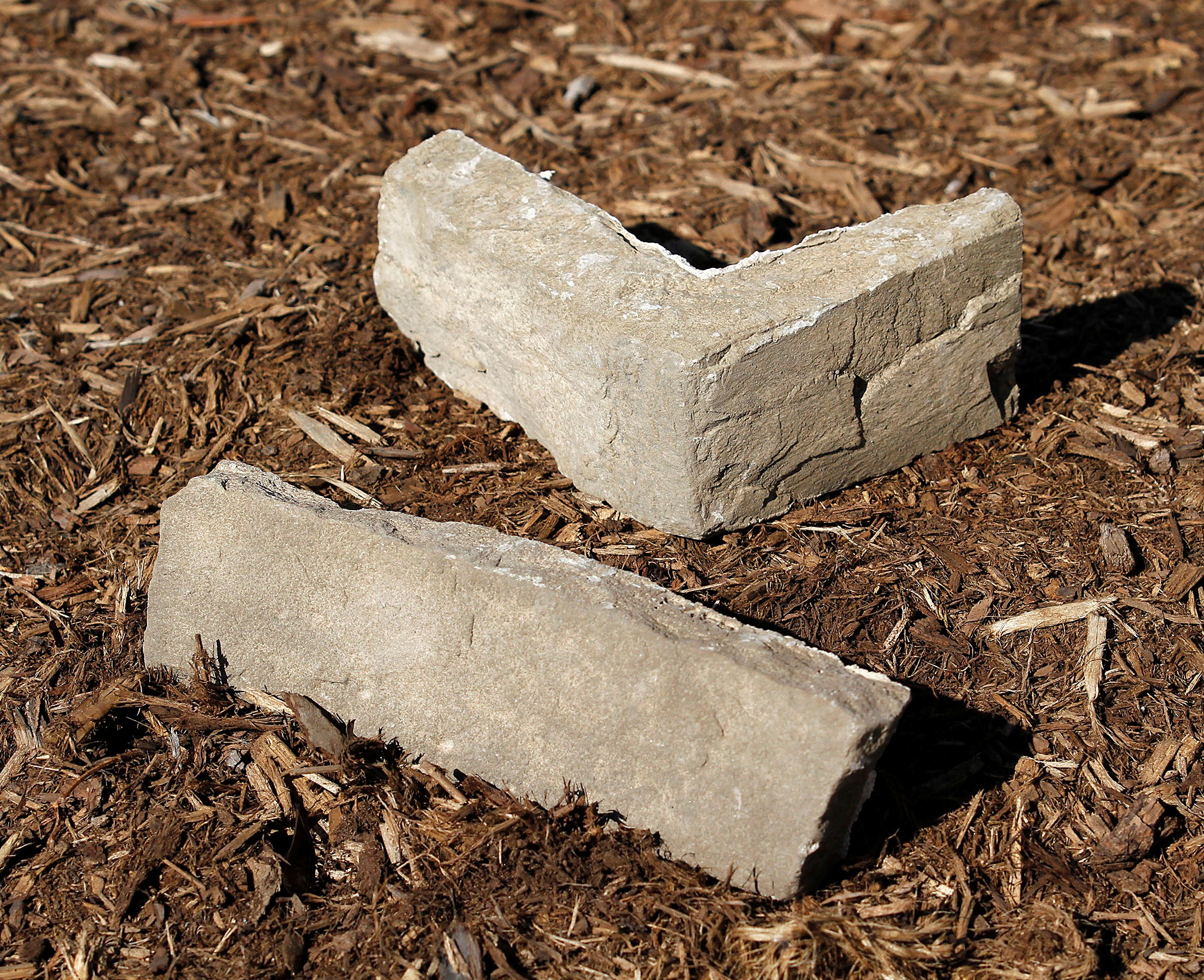 stone flats and corners in mulch garden