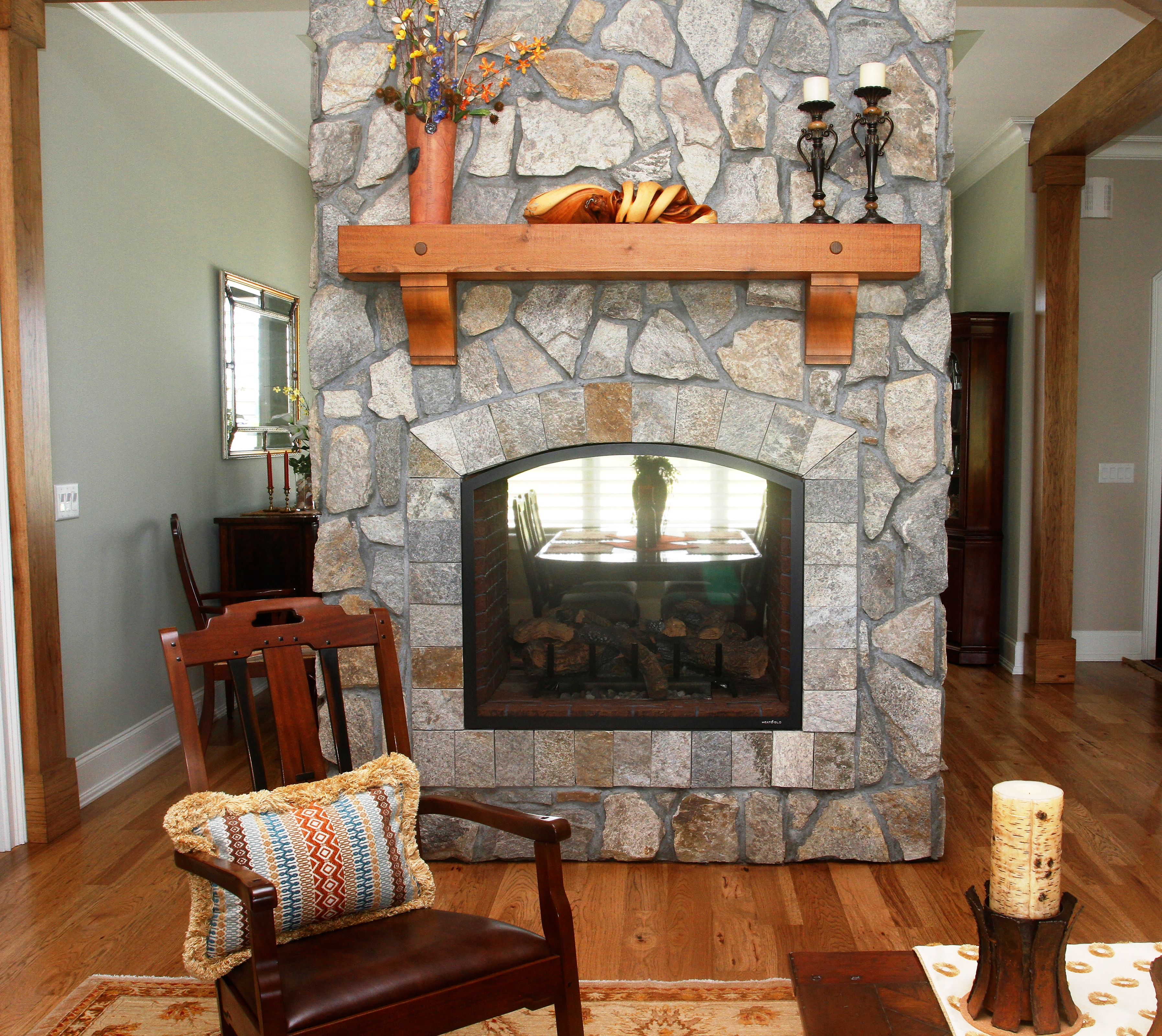 stone double-sided fireplace in a living room