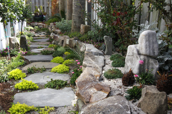 natural flagstone pathway rock garden and wooden fence