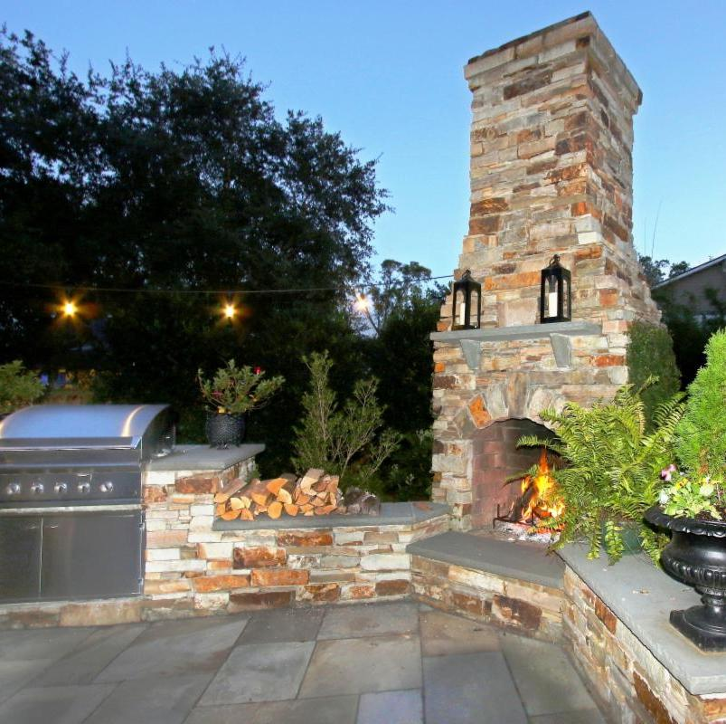TN stone outdoor fireplace with PA Bluestone wall caps