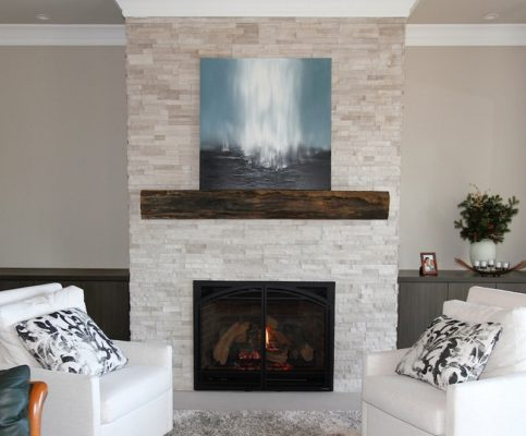 White Birch Ledgestone fireplace with limestone hearth and wooden mantel in living room