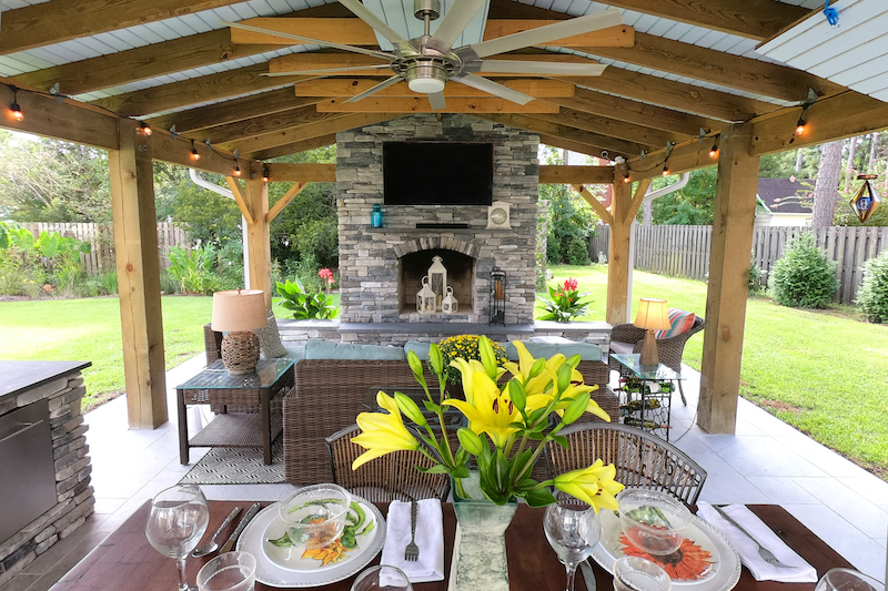 stone and wood outdoor kitchen party pavilion